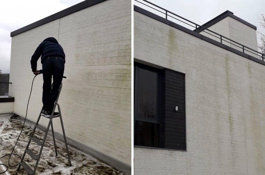 Уборщик чистит наружные стены пароочистителем